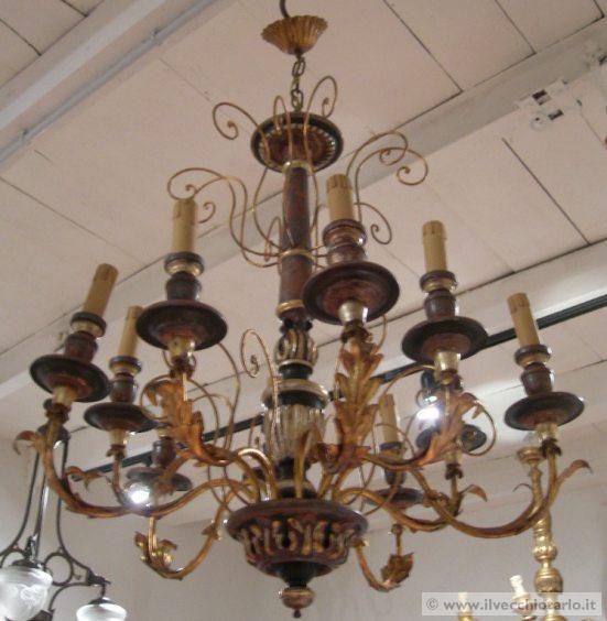 Lampadario moderno lampadario 10 luci legno ferro battuto for Lampadario legno moderno